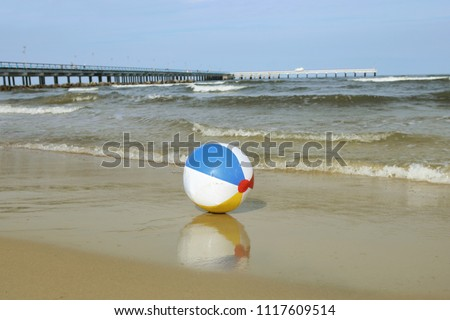 beach ball in ocean swimming pool colorful beach ball on sand and waving sea holiday near baltic sea beach ball on sand waving stock photo edit now 1117609514