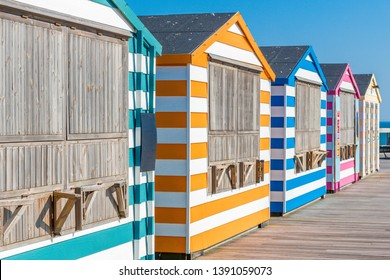 Colorful beach cabanas taken at the beach in Hastings, UK.