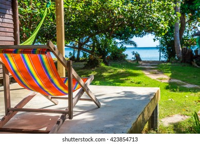 Colorful beach chair in front of resort hut Koh Mak, Trat Thailand - Selective focus