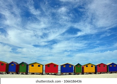 The Colorful Beach Houses At Muizenberg, Cape Town, South Africa. Lining this iconic beach are these bright and multi colored beach huts. They are primarily for rental or serve as change rooms.