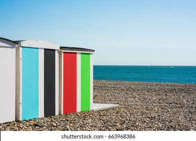 Colorful beach huts at the beach in Normandy in front of the english channel