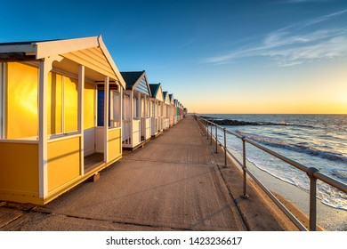 Colorful beach huts on the prom at Southwold on the Suffolk coastline