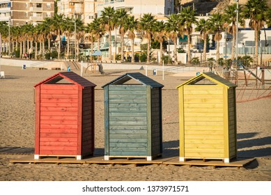 Colorful beach huts on Villajoyosa beach, Costa Blanca, Spain.