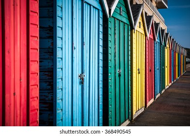 Colorful beach huts in UK