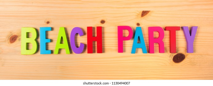 Colorful beach party in text on wood
