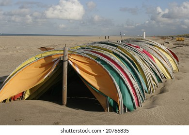 Colorful beach shelters parked for the winter