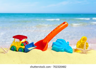 colorful beach toys on sand