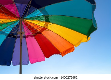 Colorful Beach Umbrella Background with Blue Sky
