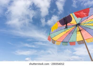 colorful beach umbrella in sky background