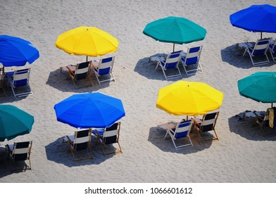 Colorful beach umbrellas from above.