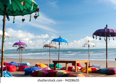 Colorful beach umbrellas and pillows in Kuta, Bali