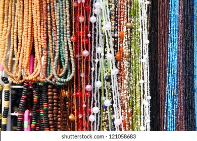Colorful beads background - necklaces at a store. Abstract jewellery.