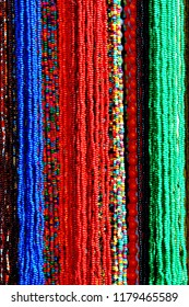 Colorful Beads Background. Background pattern of multicolored natural stone beads
