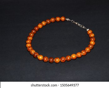 Colorful beads necklace isolated on a dark background