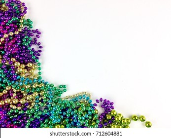 Colorful beads on a white surface with copy space
