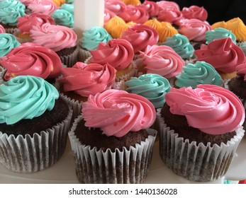 Colorful and beautiful cupcakes. delicious sweet desserts with cream.