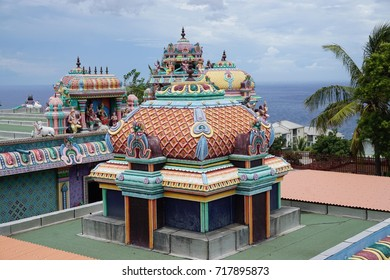 Colorful and beautiful Indian temple with an ocean view on a stormy day in La Reunion, France