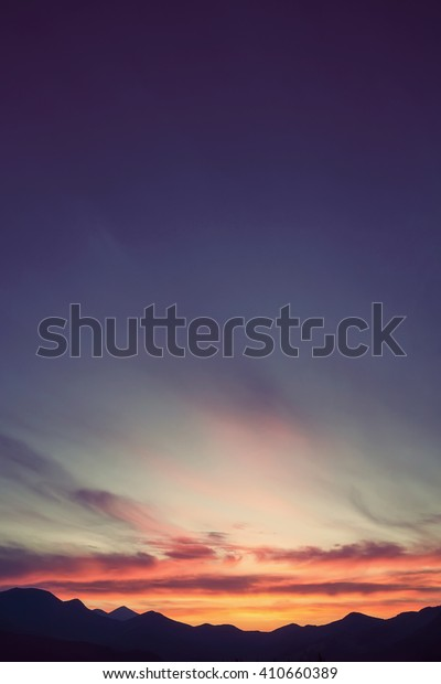 Colorful beautiful sunset over the mountain hills. Retro color.