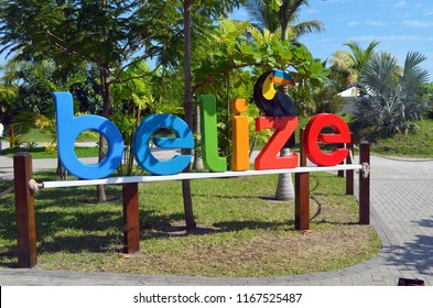 Colorful Belize signage at the entrance to Harvest Caye cruise ship leased island for use as a passenger destination.  Photographed on 24 November2017.