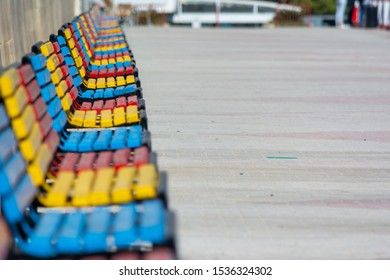 A lot of colorful benches in line on a sunny day