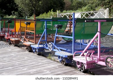 Colorful bicycle-cars in a row on rail in france for bacvkground use