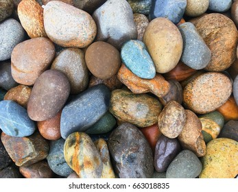Colorful big and small rocks in fresh color.