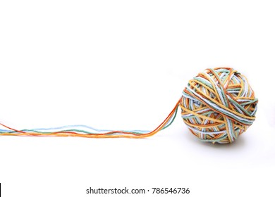 Colorful big thread ball from four color thread. Cotton thread ball isolated on white background. Different color (orange, yellow, green, blue) thread mix concept.