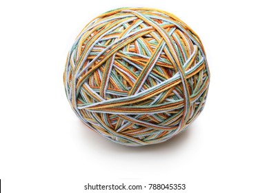 Colorful big thread ball from four color thread. Cotton thread ball isolated on white background. Different color (orange, yellow, green, blue) thread mix.