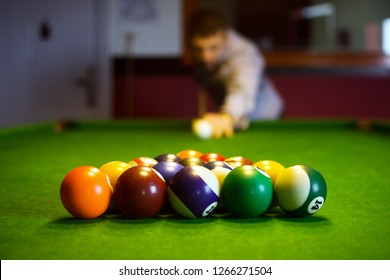 The colorful billiard or pool balls for snooker game are on green billiard table for starting the match.