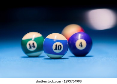 Colorful billiards balls. Billiard ball at blue table. Colorful American pool snooker balls background. American Billiard in bar. Close up Billiard balls. Bar game. Billiard table game.