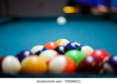 Colorful billiards balls. Billiard ball at blue table. Colorful American pool snooker balls background. American Billiard in bar. Close up Billiard balls. Bar game. Billiard table game. Colorful ball