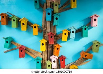 Colorful birdhouses decoration on wall