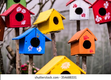 Colorful birdhouses in the garden.