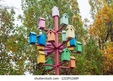 A lot of colorful birdhouses. Colorful birdhouses in the park. Life in the neighborhood. Nesting season