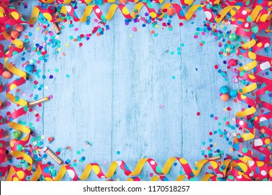 Colorful birthday or carnival frame with party items on stone background