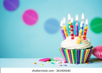 Colorful birthday cupcake with single candle