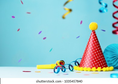 Colorful birthday party background with hat and streamers