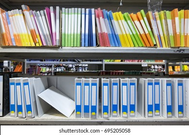 Colorful blank office folders stacking on rack for business and education concept