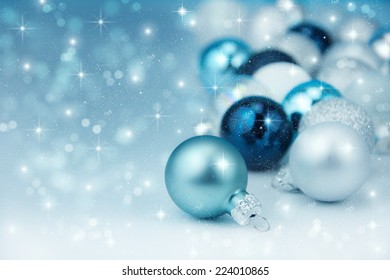 Colorful blue christmas decoration baubles on white.