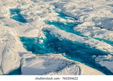 Colorful blue meltwater pools at Columbia Glacier in Alaska - aerial