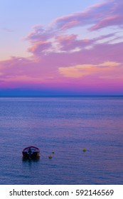 Colorful blue, pink purple and violet lights sea sunset at the bay