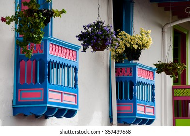 Colorful blue and red house front with flowers on balcony in Salento