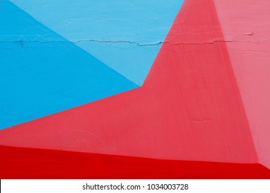 Colorful (blue, red and pink) painted wall with cracks as background or texture