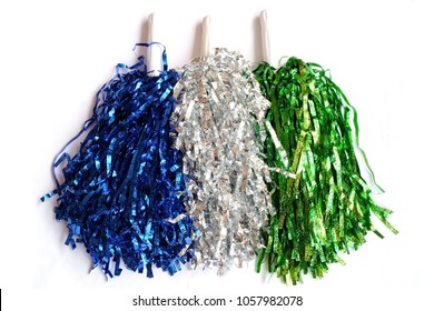 A colorful blue, silver and green pompoms on white background or pompoms isolated use for sport cheering background