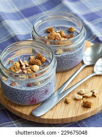 Colorful blueberry chia seed puddings for two. A trendy, delicious and healthy snack