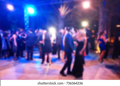 Colorful Blurred background of night dancing party  in a restaurant outdoor