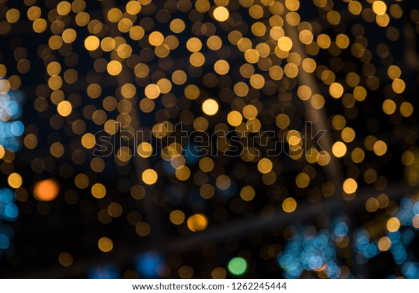 Colorful blurred lights against dark background. Christmas background