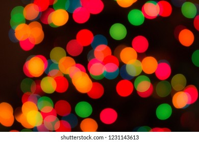 Colorful Blurry Circular Christmas Lights on a Black Background