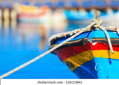 Colorful boat with rope, in Aitoliko sea lake in Central Greece
