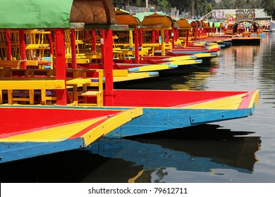 Colorful boats on a canal in Xochimilco, Mexico